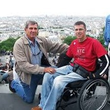 Man with Son In Wheelchair